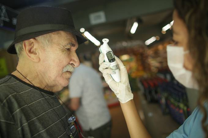 Local Supermarket Employees Check the Temperature of Clients as the Coronavirus (COVID-19) Continues to Spread