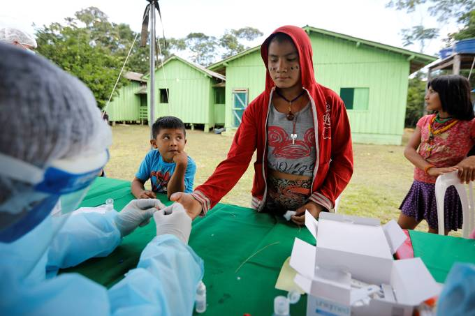 Member of the Brazilian Armed Forces medical team takes COVID-19 tests from a child from the indigenous Yanomami ethnic group, amid the spread of the coronavirus disease (COVID-19),  at the Waikas region in the municipality of Auaris