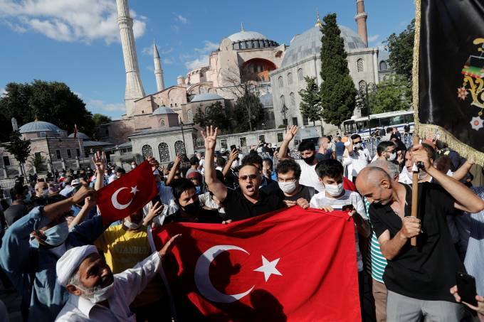 People gather in front of the Hagia Sophia or Ayasofya, after a court decision that paves the way for it to be converted from a museum back into a mosque, in Istanbul