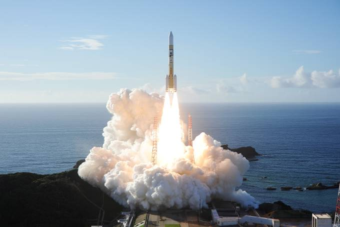 Handout photo shows an H-2A rocket carrying the Hope Probe lifts off from the launching pad at Tanegashima Space Center on the island of Tanegashima, Japan
