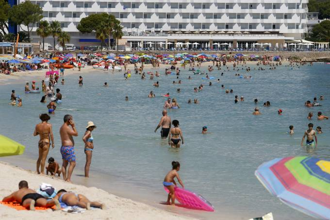 People enjoy Magaluf beach in Mallorca
