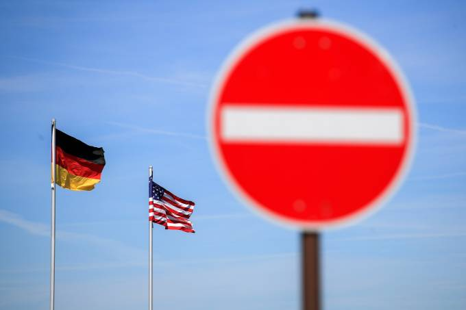 National flags of the U.S. and Germany flutter in the wind near the main gate of the U.S. Spangdahlem Air Base near Bitburg