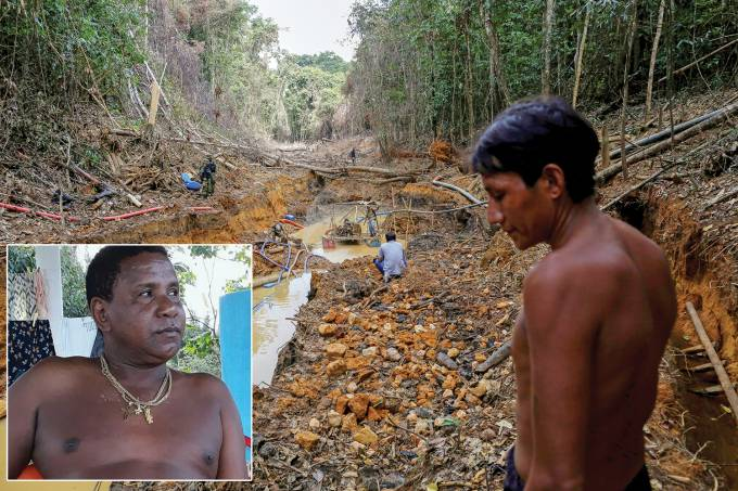 A Yanomami indian follows agents of Brazil's environmental agency in a gold mine during an operation against illegal gold mining on indigenous land, in the heart of the Amazon rainforest