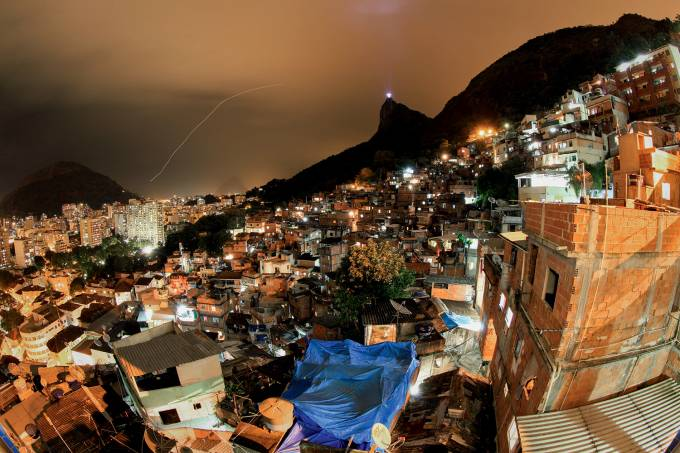 Night view from top of Favela Santa Marta –  Christ the