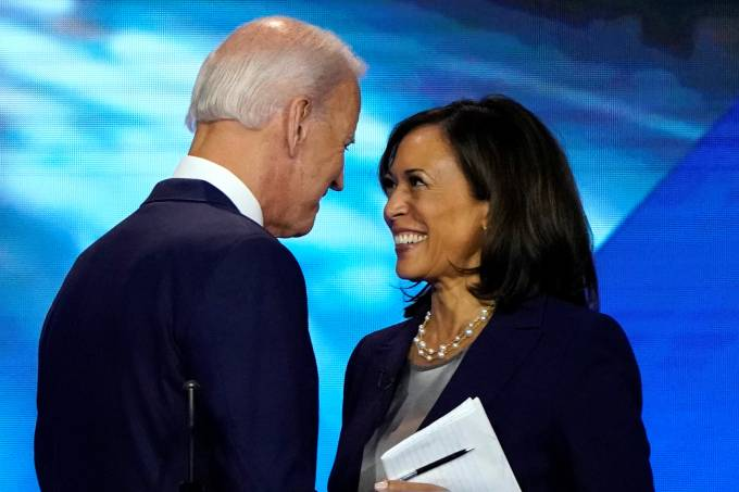 FILE PHOTO: Former Vice President Biden talks with Senator Harris