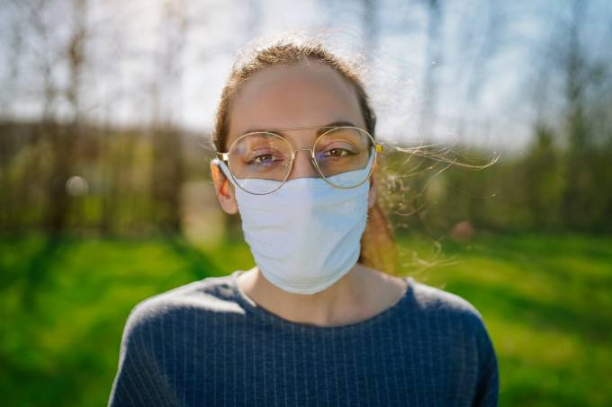 Woman In The Nature Wearing Protective Face Mask