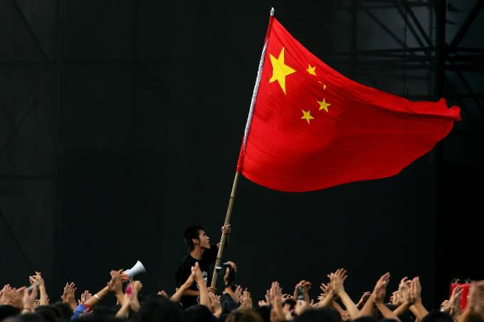 Chinese teenager waves a national flag – China