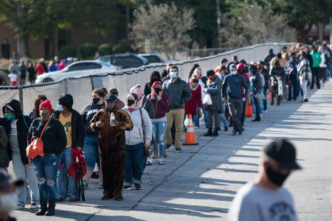 Voters Wait In Long Lines To Cast Early Ballots In South Carolina