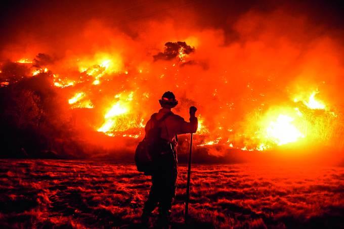 A firefighter works at the scene of the Bobcat Fire burning on hillsides near Monrovia, California, on September 15