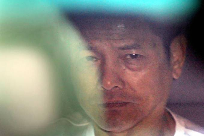 """Wan Kuok-koi, better known as """"Broken Tooth Koi"""", a former notorious triad leader in Macau, is released from Coloane Prison  (Estabelecimento Prisional de Macau). Coloane Prison  (Estabelecimento Prisional de Macau), Coloane, Macau. 01DEC12"""