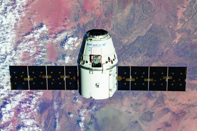 The SpaceX Dragon resupply ship is pictured approaching the International Space Station as both spacecraft were soaring 267 miles above the African nation of Namibia.