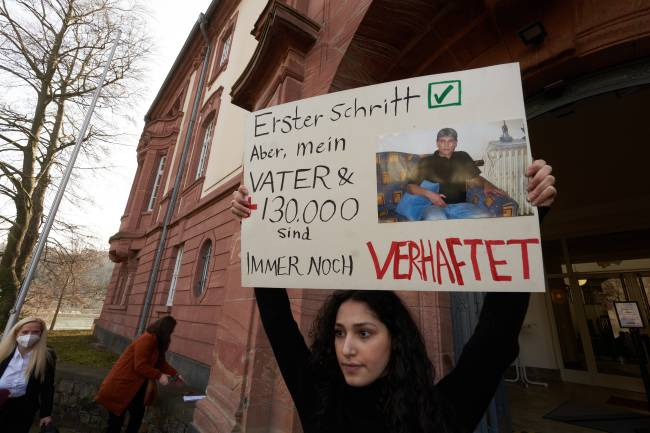 24 February 2021, Rhineland-Palatinate, Koblenz: Serda Alshehabi comments on the verdict in front of the building of the Higher Regional Court. According to her, her father has been in custody in Syria since 2012. A 44-year-old man who fled to Germany and was arrested here had been an agent of the state-run General Intelligence Service in Syria. According to the court, he was guilty of torture and deprivation of liberty. Photo: Thomas Frey/dpa (Photo by Thomas Frey/picture alliance via Getty Images)