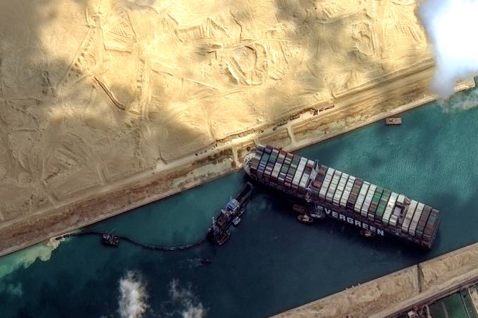 STUCK SHIP EVER GIVEN, SUEZ CANAL — MARCH 26, 2021:  Maxars WorldView-2 collected new high-resolution satellite imagery of the Suez canal and the container ship (EVER GIVEN) that remains stuck in the canal north of the city of Suez, Egypt.