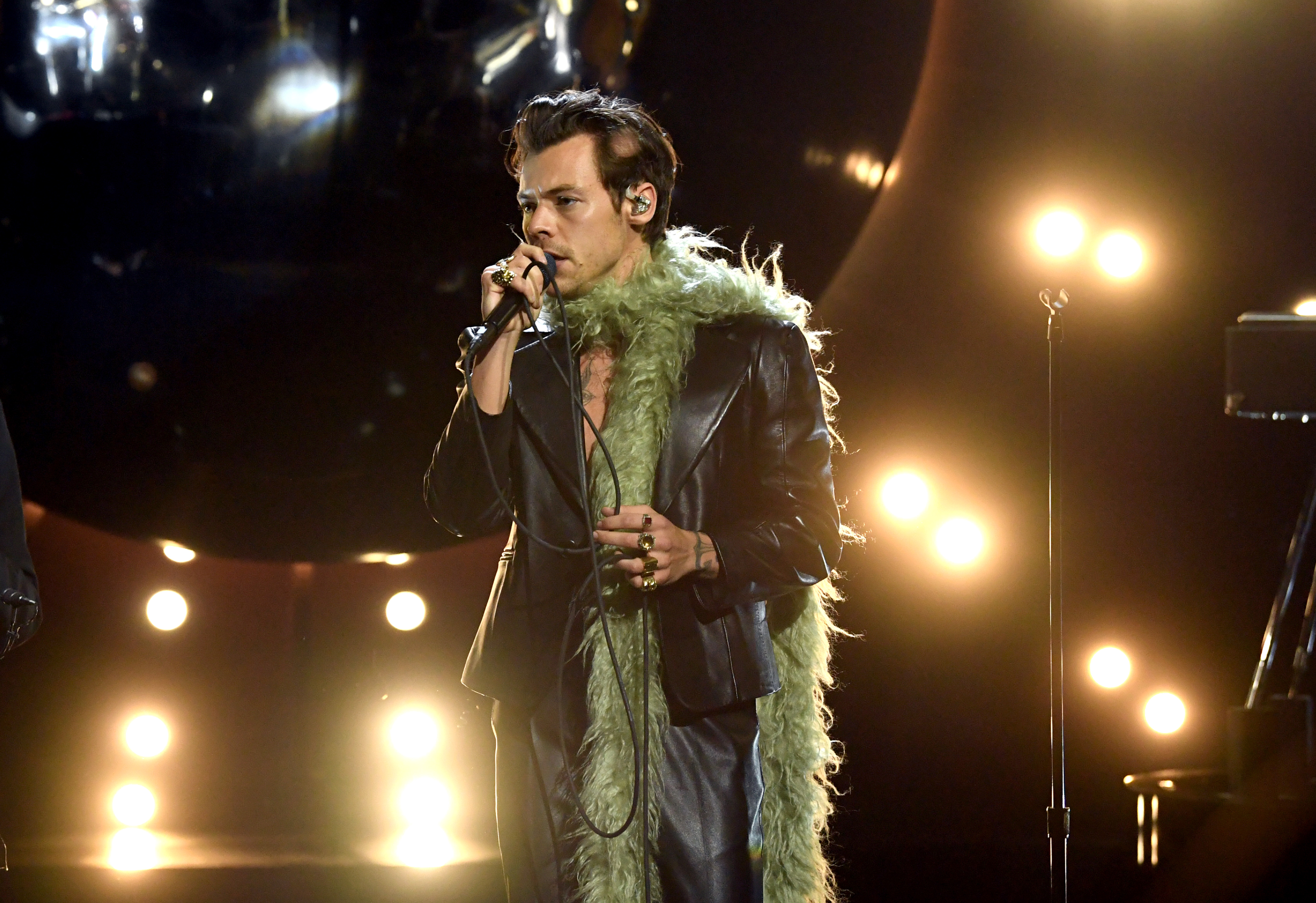 LOS ANGELES, CALIFORNIA: In this image released on March 14, Harry Styles performs onstage during the 63rd Annual GRAMMY Awards at Los Angeles Convention Center in Los Angeles, California and broadcast on March 14, 2021. (Photo by Kevin Winter/Getty Images for The Recording Academy)
