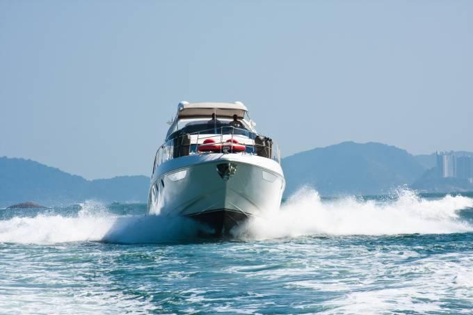 White yacht sailing in a calm sea