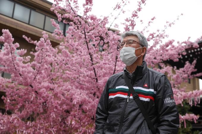 A man wearing a face mask seen at Sakura Jingu Shrine.The
