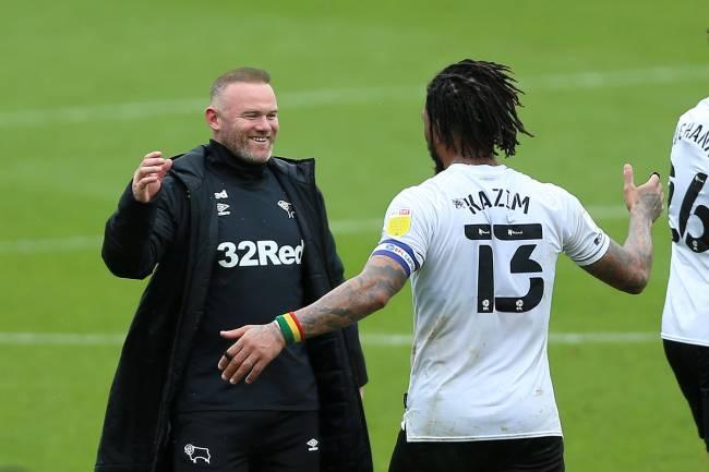 Wayne Rooney e Kazim celebram permanência na segunda divisão
