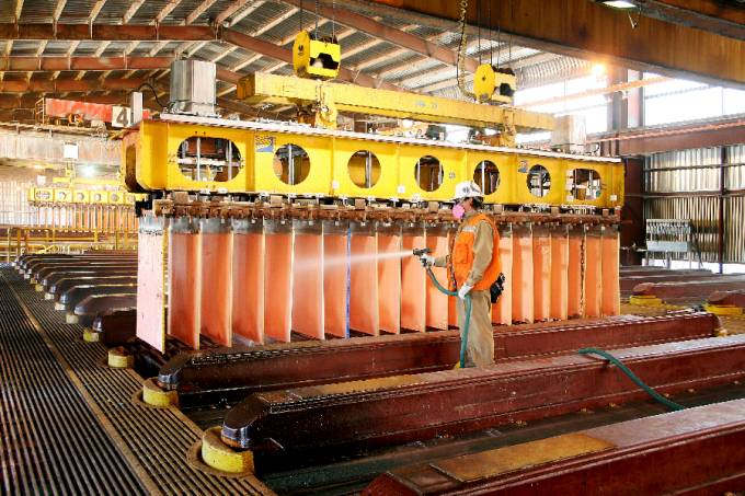 Worker Cleaning Copper Cathodes In Escondidas Electro Winning Shed, Chile.