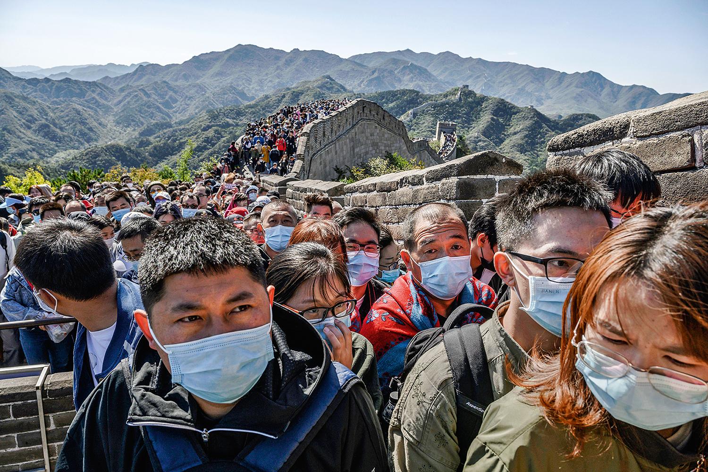 APERTO- Multidão na Muralha: até o fim do século, a China pode ter metade de seu 1,4 bilhão de habitantes -