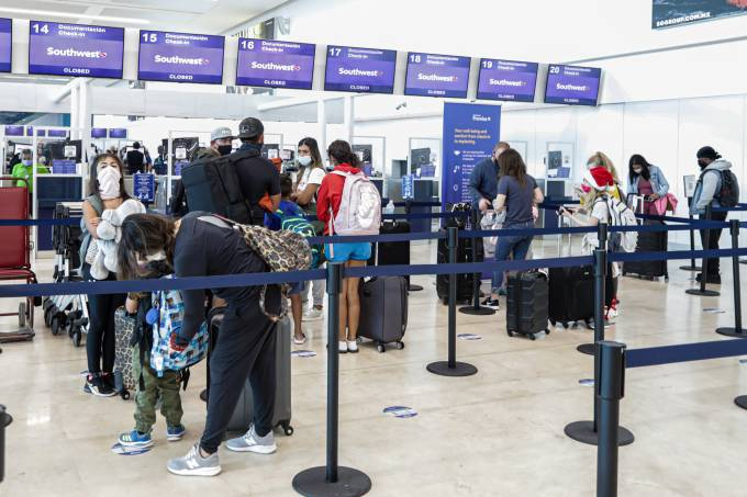 Travelers Arrive At Cancun International Airport During Christmas Holidays