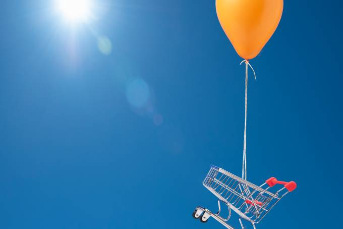 Shopping cart being carried by balloon