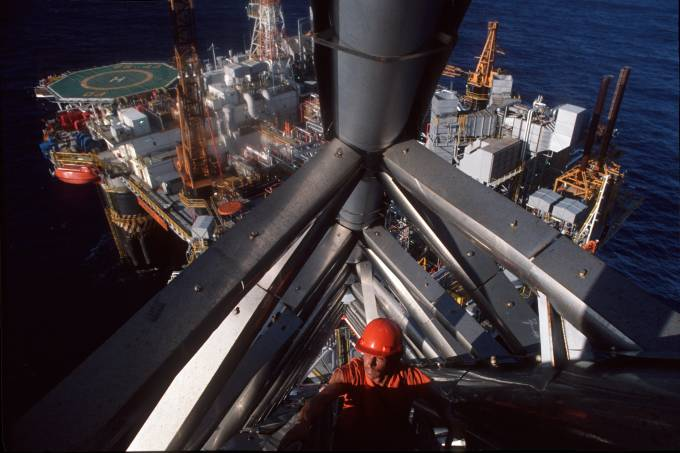 Petroleum industry in Brazil, worker clibing staircase at