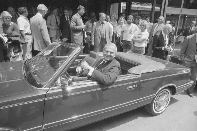 Lee Iacocca Siting in Chrysler Convertible
