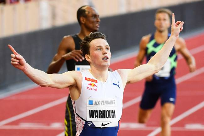 Norway's Karsten Warholm celebrates as he wins the Men's 400m Hurdles during the IAAF Diamond League competition on July 9, 2021 in Monaco. (Photo by CLEMENT MAHOUDEAU / AFP)
