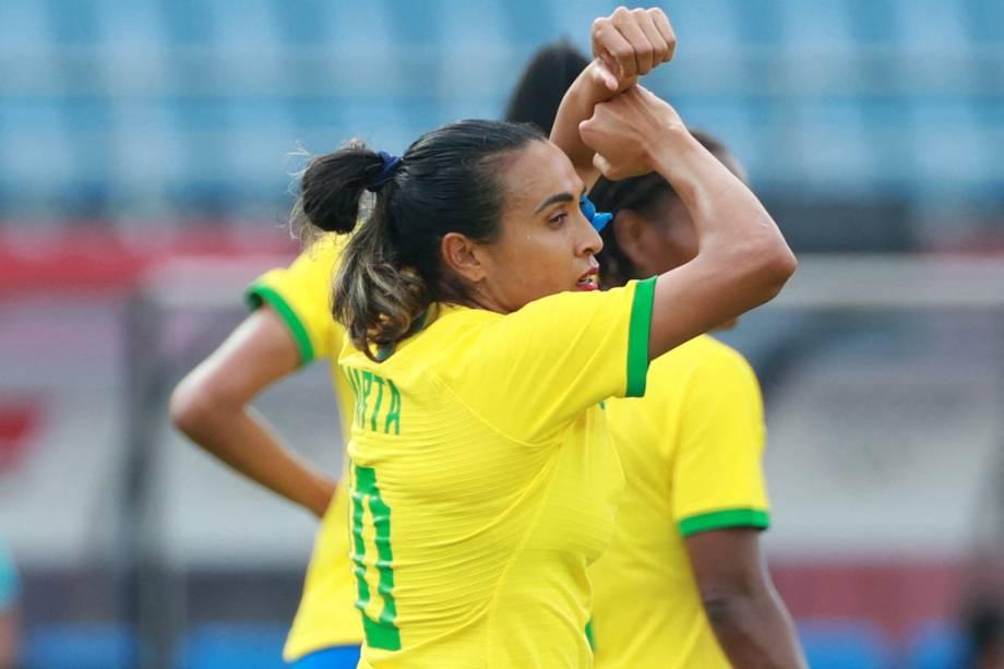 Marta comemora o gol de abertura de placar contra a China -