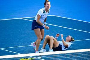 Brazil's Laura Pigossi (Bottom) and Brazil's Luisa Stefani celebrate after defeating Russia's Veronika Kudermetova and Russia's Elena Vesnina during the Tokyo 2020 Olympic Games women's doubles tennis match for the bronze medal at the Ariake Tennis Park in Tokyo on July 31, 2021. (Photo by Vincenzo PINTO / AFP)