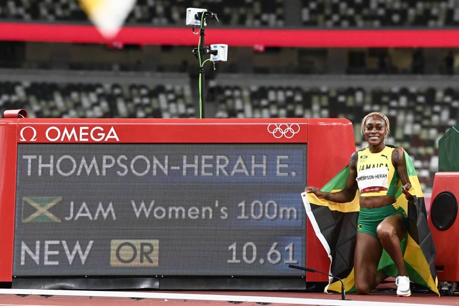 Thompson posa diante do novo recorde olímpico -