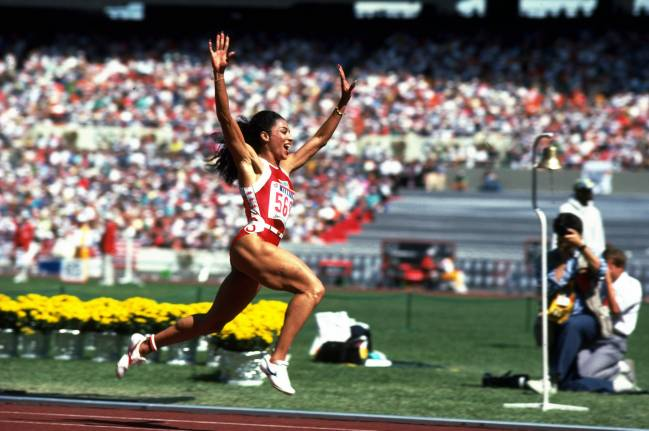 1988: Florence Griffith Joyner of the USA celebrates her 100m win during the 1988 Olympic Games in Seoul, Korea Sergio Berezovsky