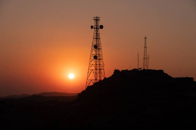 Silhouette of communication tower for broadcasting during sunrise time.