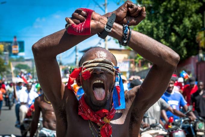 Haitians demonstrate during a protest to denounce the draft constitutional referendum carried by the President Jovenel Moise on March 28, 2021 in Port-au-Prince, Haiti