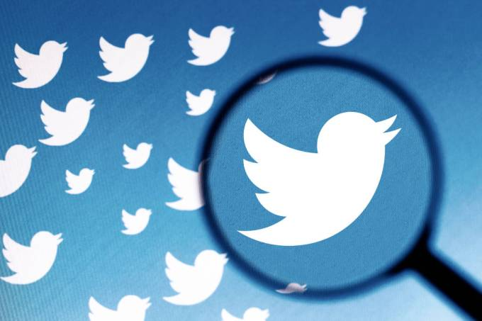 In this photo illustration a Twitter logo is seen on a