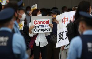 TOKYO, JAPAN JULY 23, 2021: People protest against the Tokyo 2020 Summer Olympic Games outside the National Stadium. Tokyo was to host the 2020 Summer Olympics from 24 July to 9 August 2020, however because of the COVID-19 pandemic the games have been postponed for a year and are due to take place from 23 July to 8 August 2021. Valery Sharifulin/TASS (Photo by Valery SharifulinTASS via Getty Images)