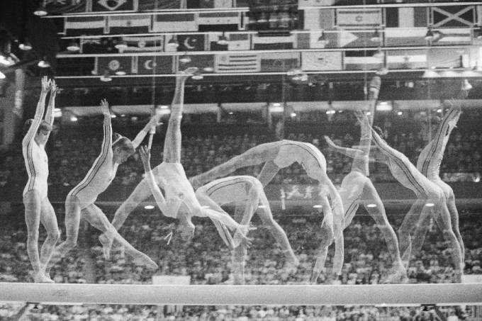 Multiple exposure show's Romania's Nadia Comaneci on the balance beam in Olympic women gymnastics 7/22, as she went on to win her second gold medal of the night, and her third of the games.