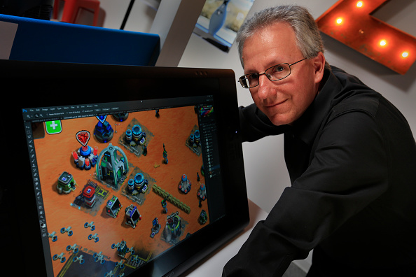 """LOS ANGELES CA. FEBRUARY 24, 2015:    Mike Verdu, with the video game """"This Means War"""", at the Kabam"""