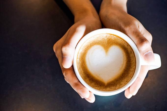 hand and art on coffee