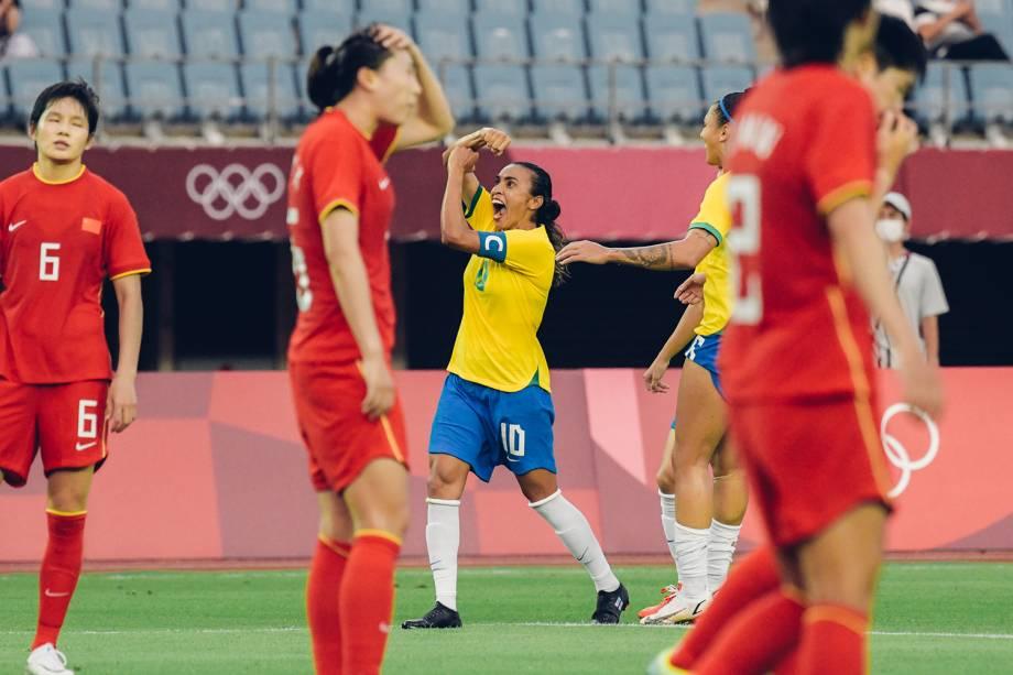 Marta em comemoração de gol em homenagem à noiva, Toni Pressley -
