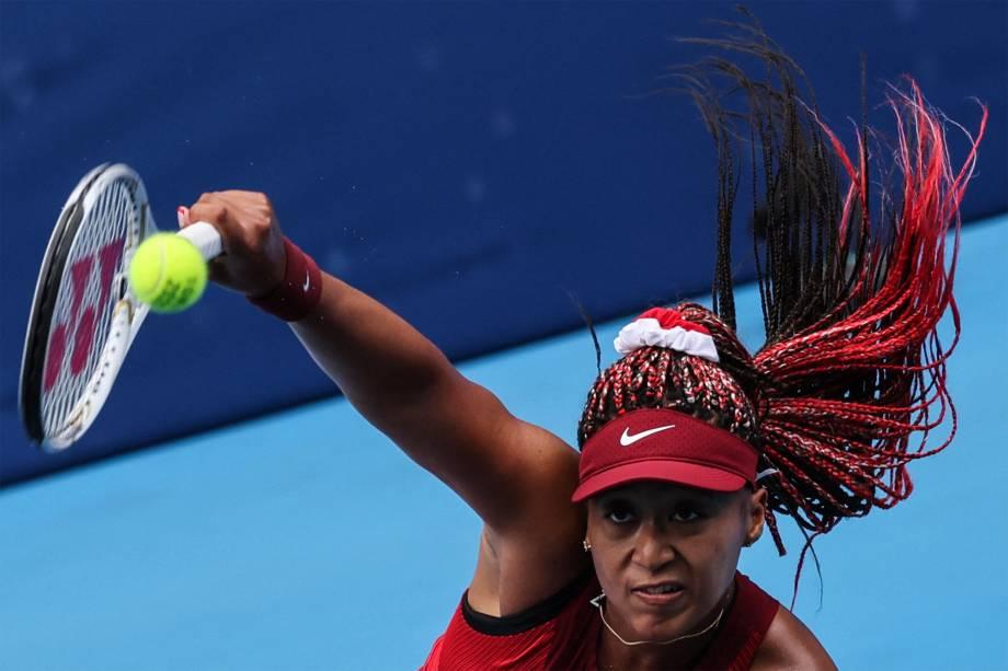 A japonesa Naomi Osaka em partida de tênis contra Viktorija Golubic, da Suíça -