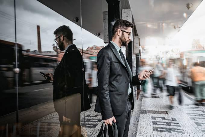 Businessman on street using cellphone