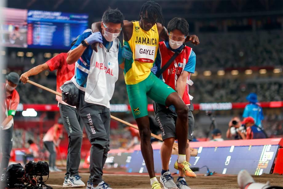 Tajay Gayle, da Jamaica, sofre lesão na prova classificatória de salto em distância -