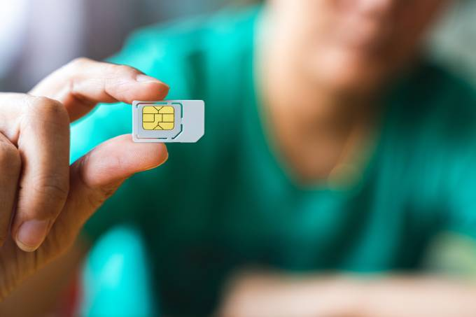 Close-Up Of Woman Holding Sim Card