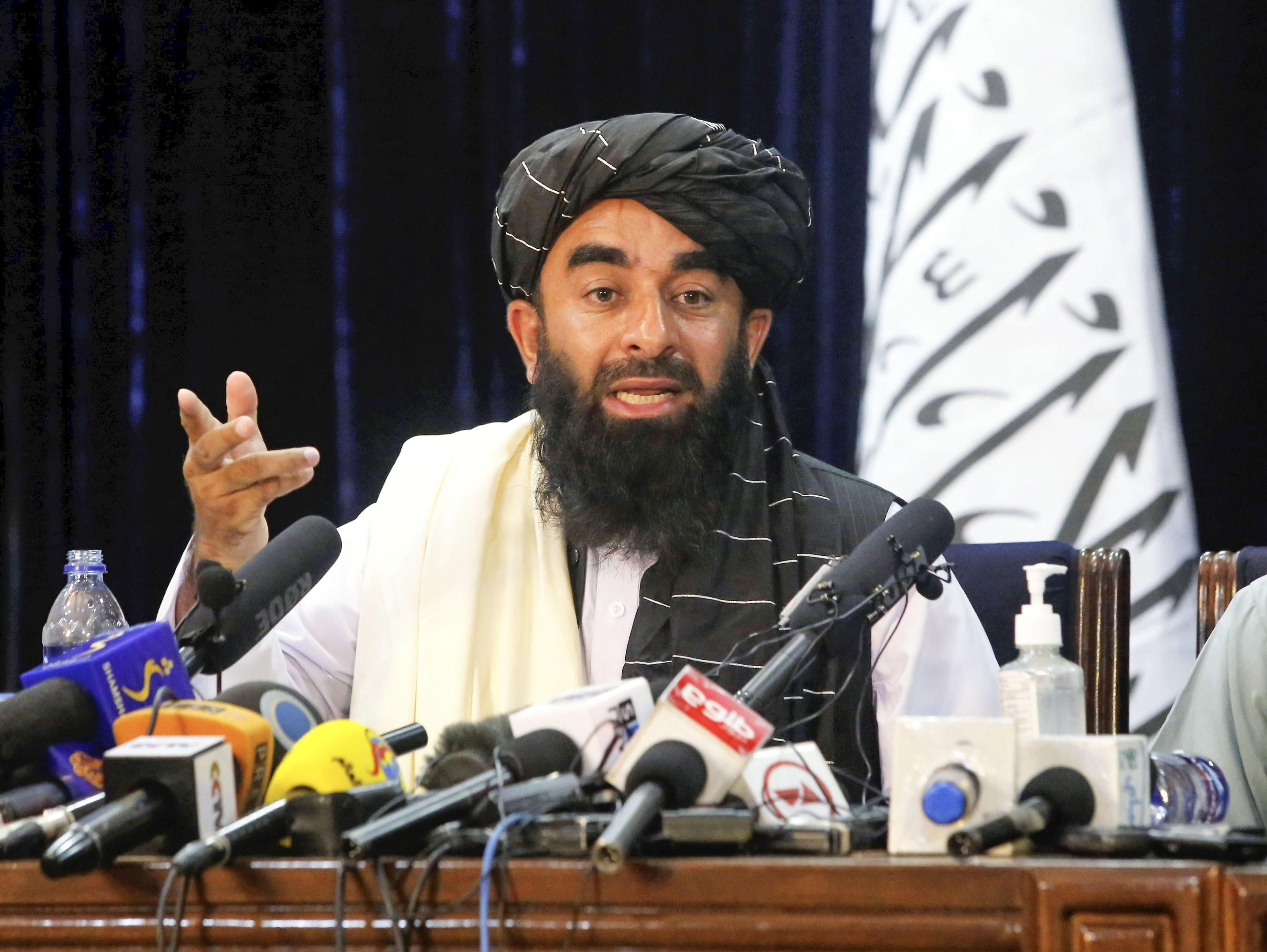 Taliban spokesman Zabihullah Mujahid attends on Aug. 17, 2021, in Kabul the first press conference held by the Islamic militant group since it seized power in Afghanistan. (Photo by Kyodo News via Getty Images)