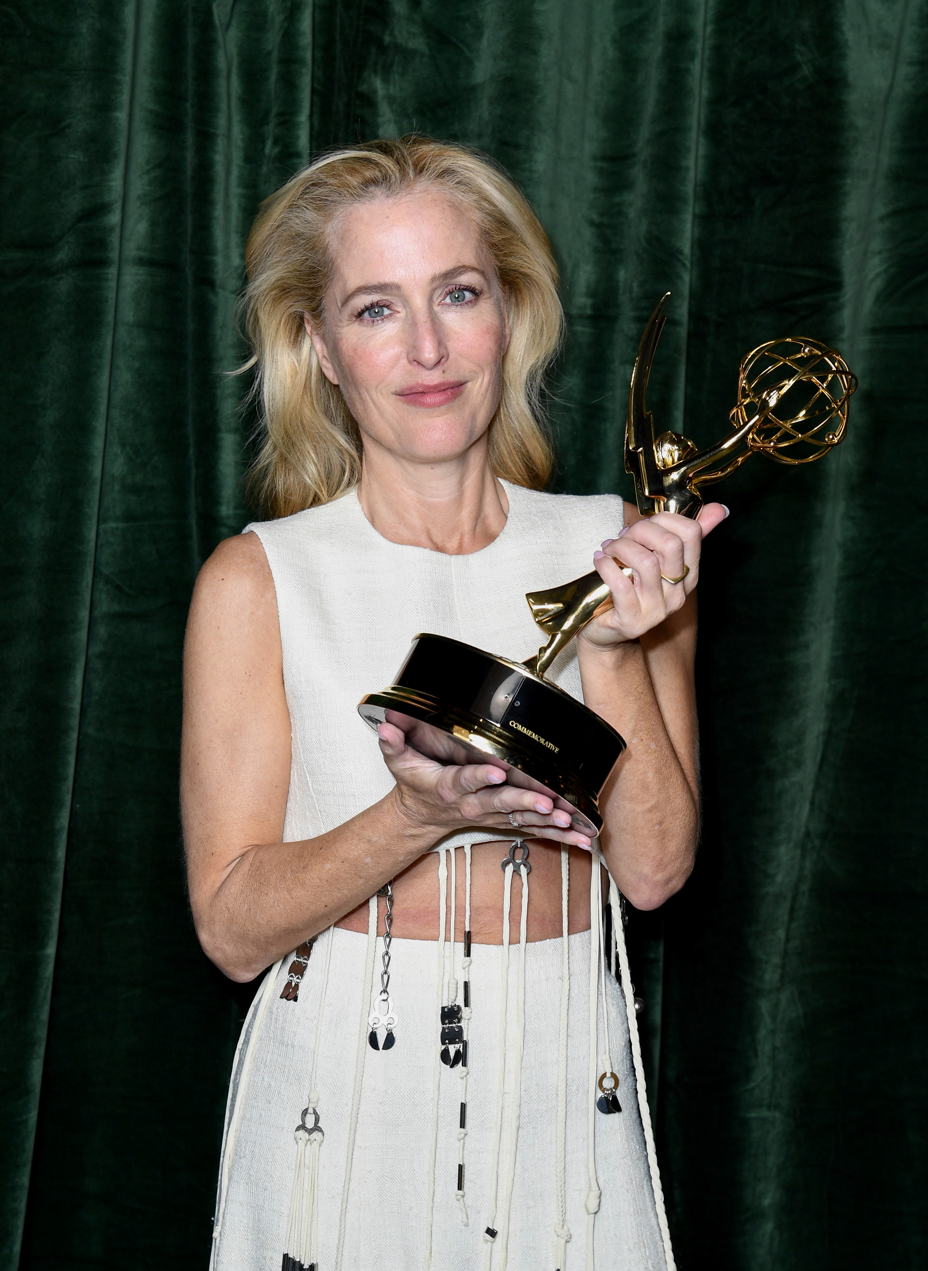 LONDON, ENGLAND - SEPTEMBER 19: Gillian Anderson with her Emmy award for 'Outstanding Supporting Actress for a Drama Series', at the