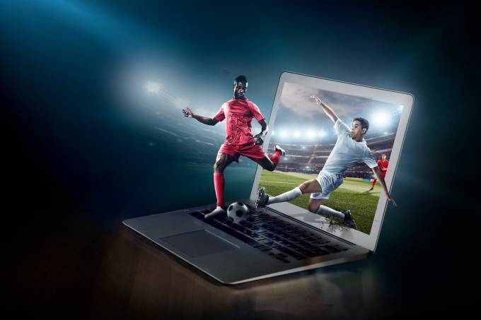 Soccer game on laptop. Live broadcast