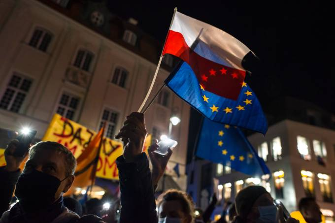 Protesters hold EU and Polish flags during the pro-EU rally